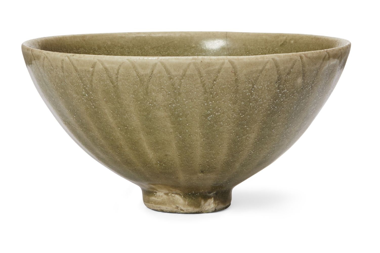 A grey stoneware celadon glazed moulded bowl, 15th/16th century, moulded to the exterior with