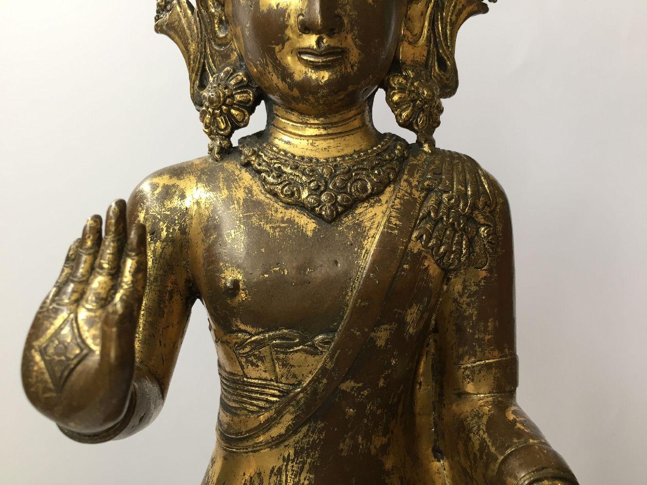 A large Sino-Tibetan gilt bronze standing figure of Avalokiteshvara, 17th century, the right hand is - Image 11 of 16