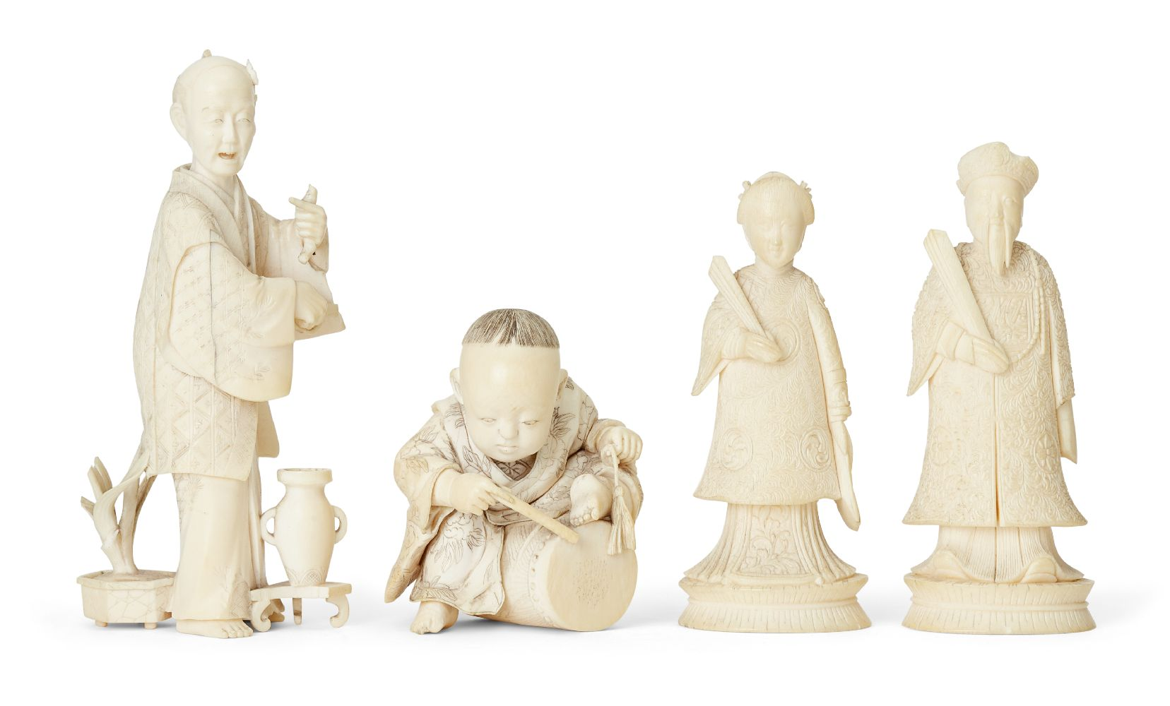 Four Japanese ivory okimono Meiji Period, to include a young boy playing a drum with polychrome