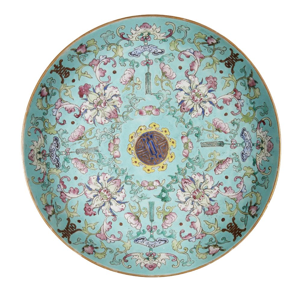 A Chinese porcelain 'sanduo' dish, 19th century, painted in famille rose enamels on a turquoise