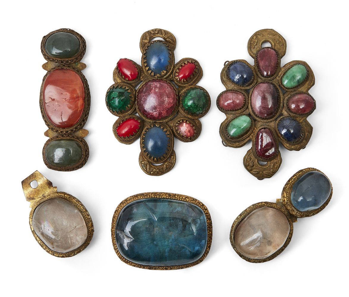 Five Chinese/Tibetan hardstone set buckles, 19th century, to include a two-piece buckle with gilt