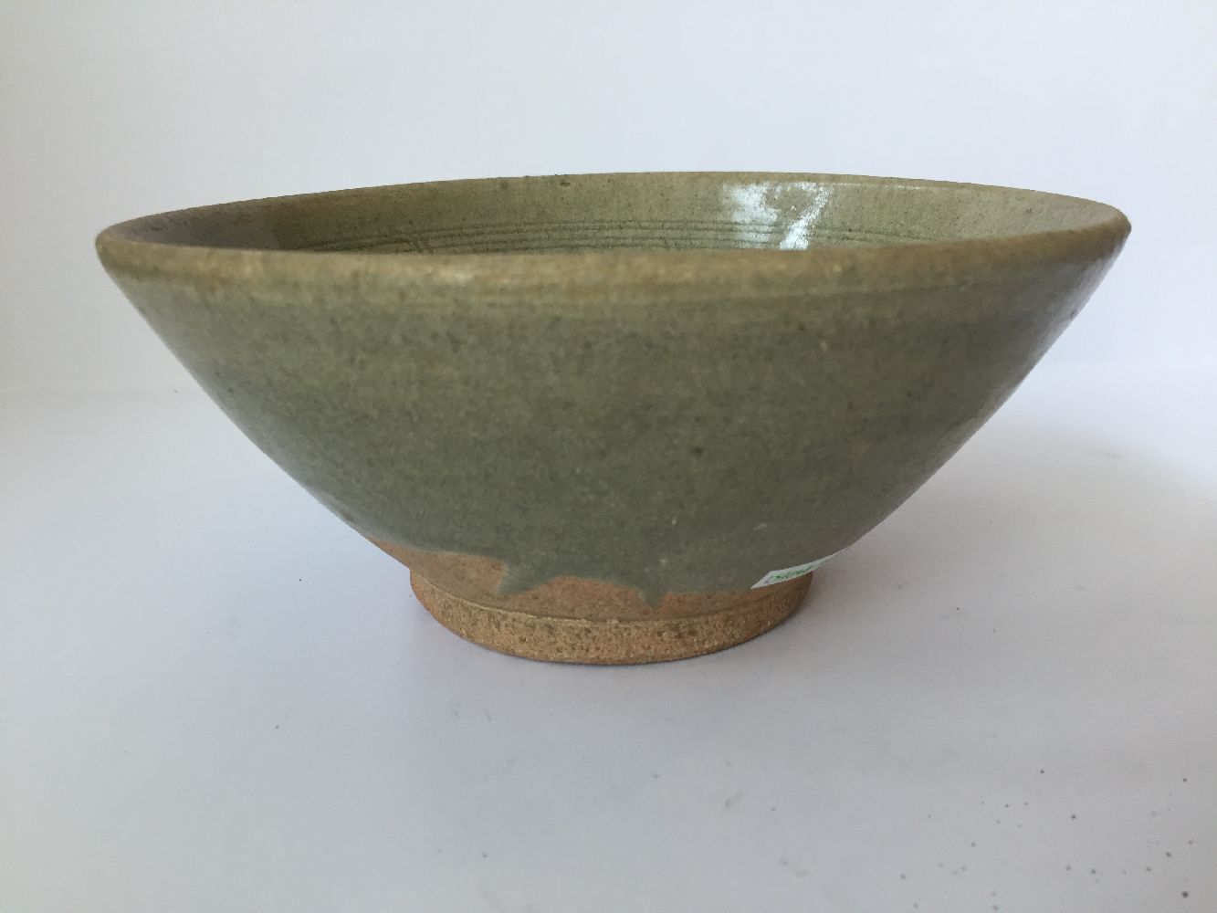 Three Thai Sawankhalok bowls, 15th-16th century, each covered in a celadon glaze, two with fluted - Image 4 of 27