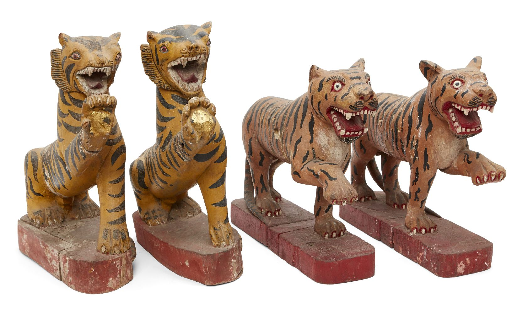 Four Burmese painted wood tigers, Tai Yai (Shan States), early 20th century, each roaring with paw