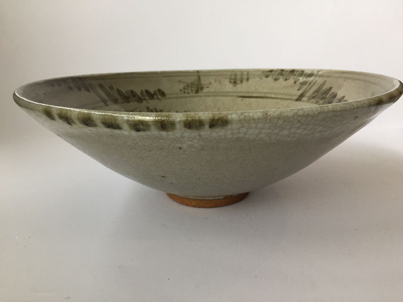 Three Thai Sawankhalok bowls, 15th-16th century, each covered in a celadon glaze, two with fluted - Image 8 of 27