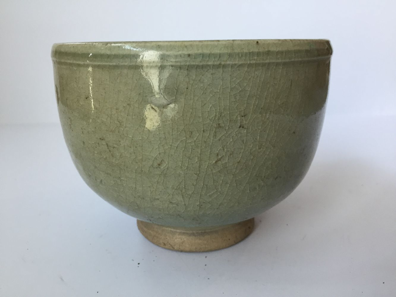 Three Thai Sawankhalok bowls, 15th-16th century, each covered in a celadon glaze, two with fluted - Image 22 of 27
