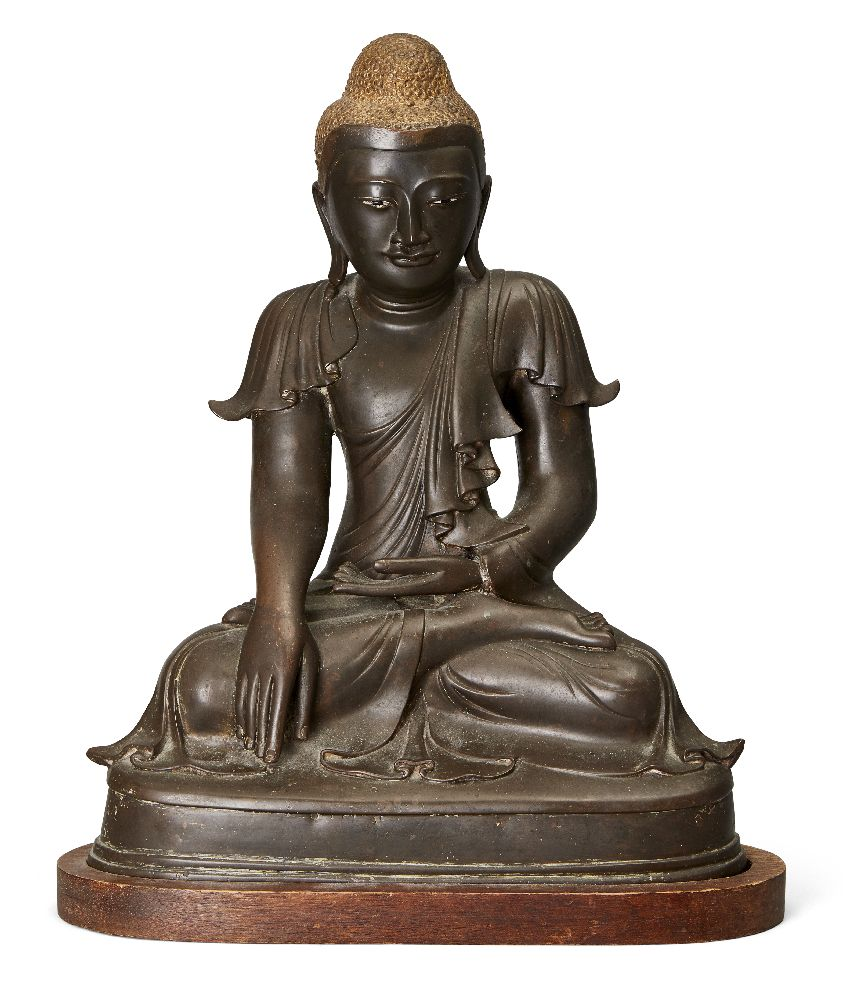 A Burmese bronze figure of Buddha, Mandalay period, 19th century, cast seated in vajrasana, his