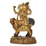 Property of a Gentleman (lots 36-85) A Sino-Tibetan gilt-bronze figure of Green Tara on a Buddhist