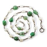 A South Indian emerald and pearl necklace, 19th century, with silver chain links between the