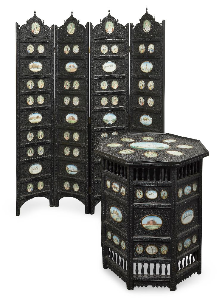 A finely carved ebony four-fold screen and occasional table, North India, second half 19th