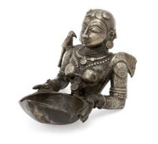 The upper section of a finely moulded brass figure of Meenakshi, the avatar of goddess Pavarti,