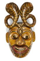 A South Indian papier mache wood dance mask, Kerala, India, late 19th-early 20th century, 31.5cm.