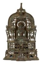 A Jain brass alter piece, Western India, 19th century, cast with a jina seated in meditation on a