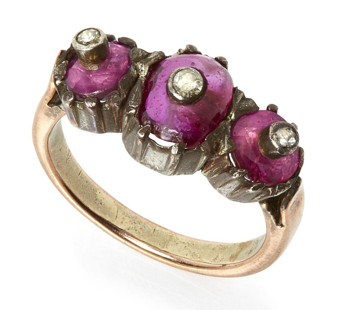 A ruby and diamond three-part ring, India, 19th- early 20th century, the rose gold ring with a