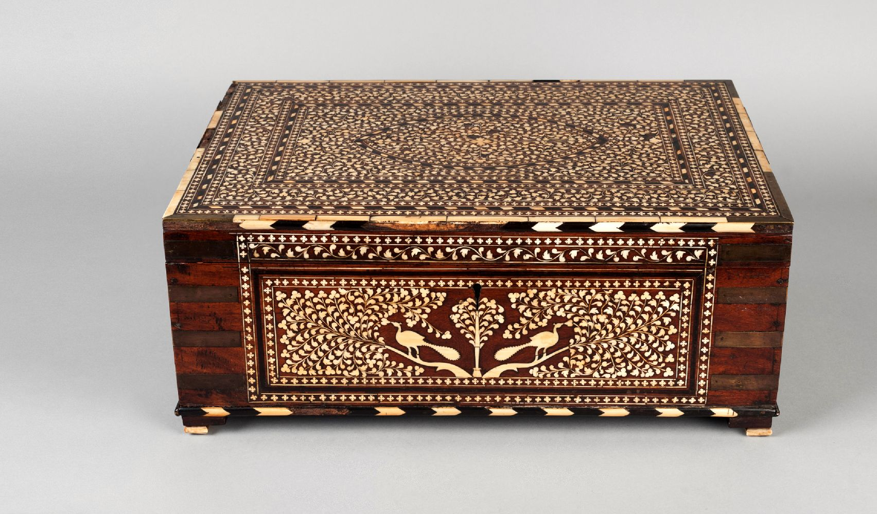 A large Horshiapur ivory inlaid chest, India, 19th century, of rectangular form, with hinged lid,