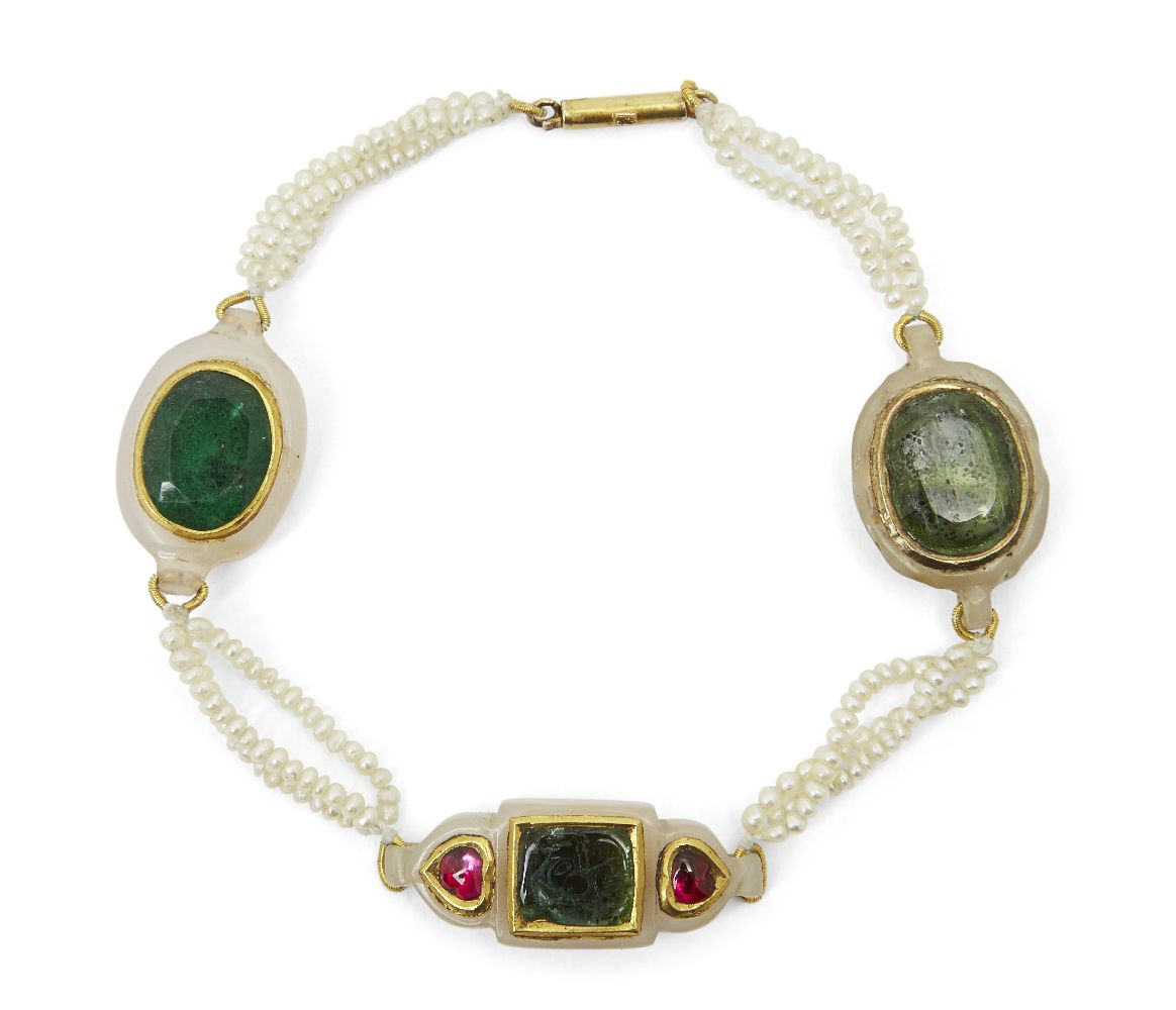 A gem-set jade and seed pearl bracelet, India, late 19th century, with three jade elements set