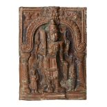 A copper votive plaque of Shiva, South India, 19thcentury, of rectangular form, Shiva depicted in
