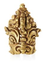 A Gupta gold hair ornament of Kirtimukha, India, 5th-8th century, in the form of a male mask with