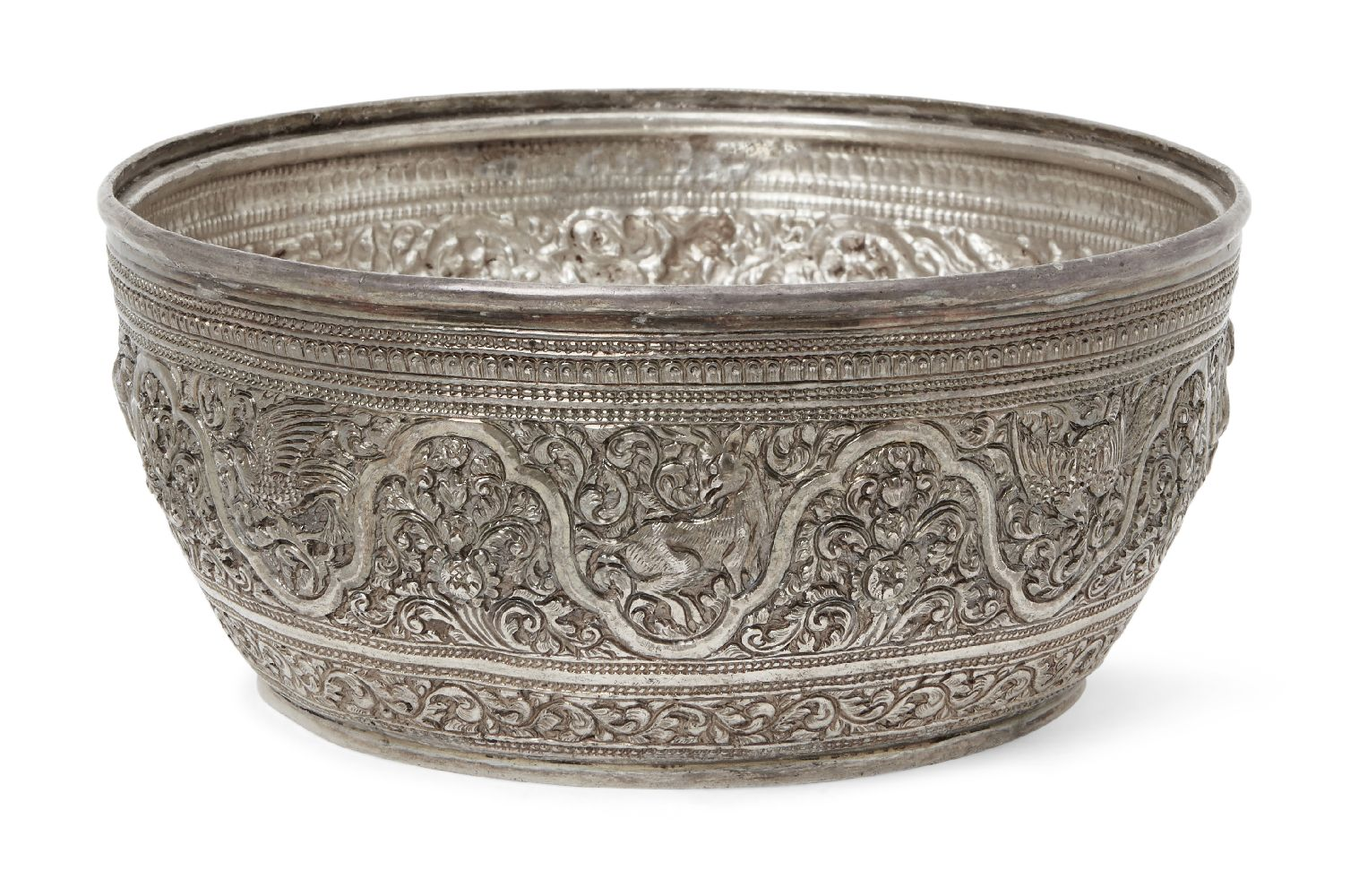 A Malaysian silver bowl, 19th century, of deep form, decorated to exterior with a series of