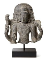A black stone sculpture of Shiva, India, 19th century in a 10th century style, carved wearing a