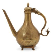 A unusually large cast brass lidded ewer, Mughal India, 18th century, the pear-shaped body on