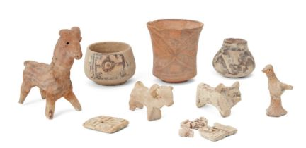 A group of Proto-Indus valley animal figures, comprising a three slip-painted vessels, a model of