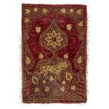 A gilt metal thread embroidered red velvet textile with tiger, India, 19th century, of rectangular