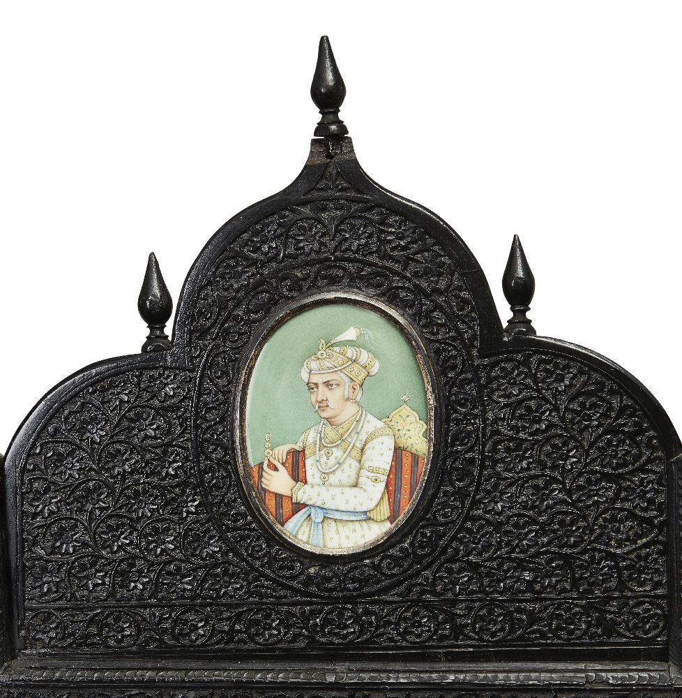 A finely carved ebony four-fold screen and occasional table, North India, second half 19th - Image 3 of 7