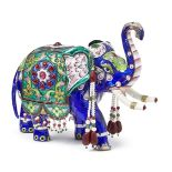 An enamelled silver elephant and peacock, India, 20th century, the elephant with stone and bead