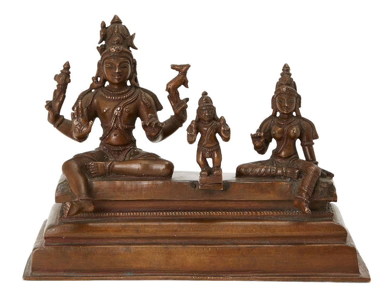 A Tamil Nadu copper figural group of Shiva, Parvati and Skanda (Somaskanda), South India, 19th