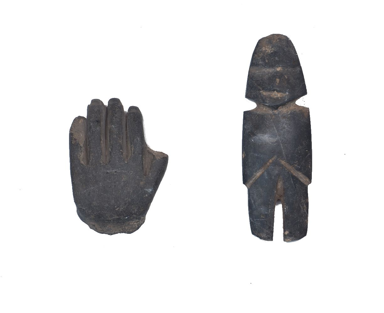 A carved stone Easter Island style figure, 17cm high; together with a carved a stoneware hand