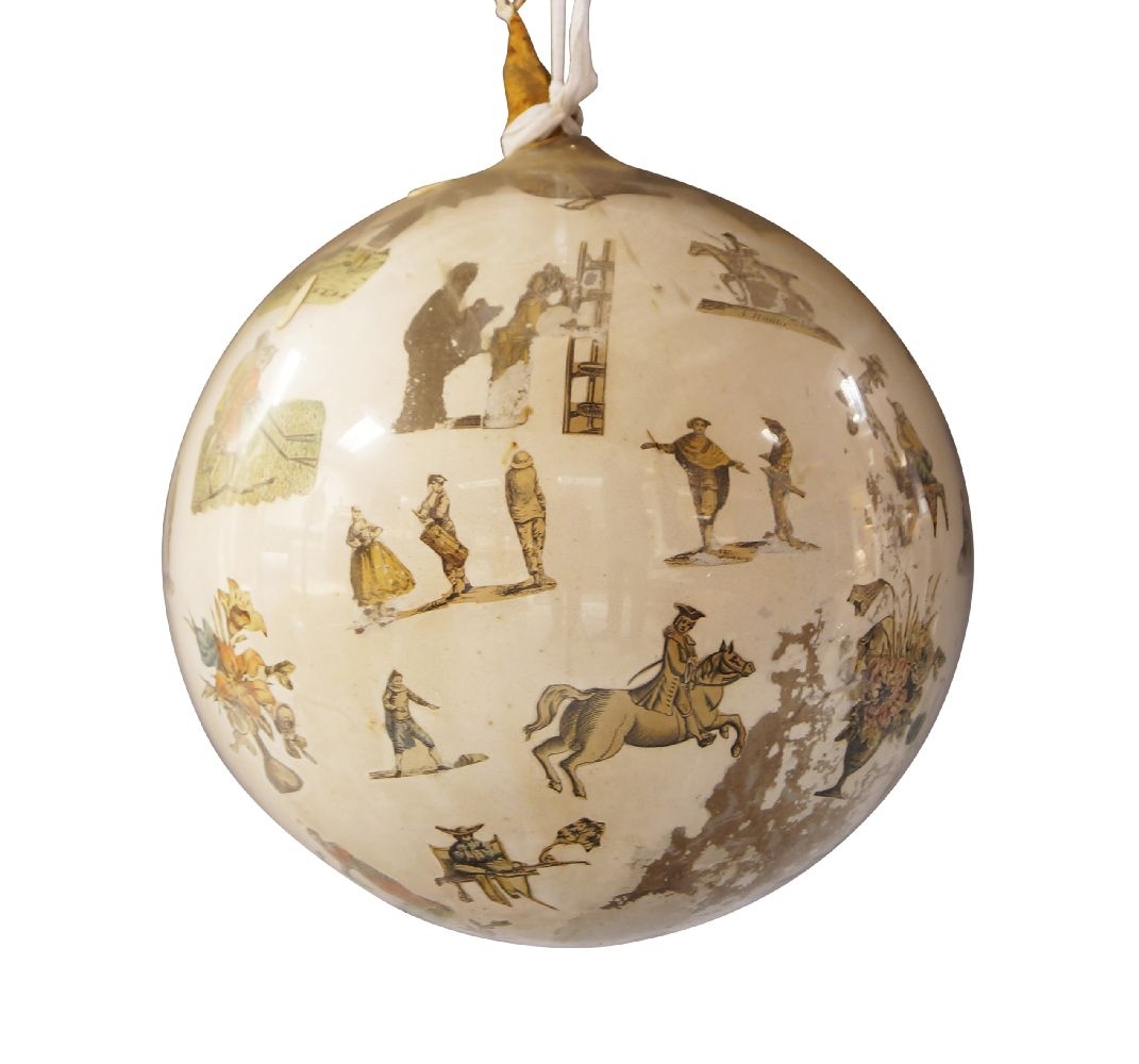 A glass Decalcomania ball, late 19th century, applied with prints of Oriental figures and sprays