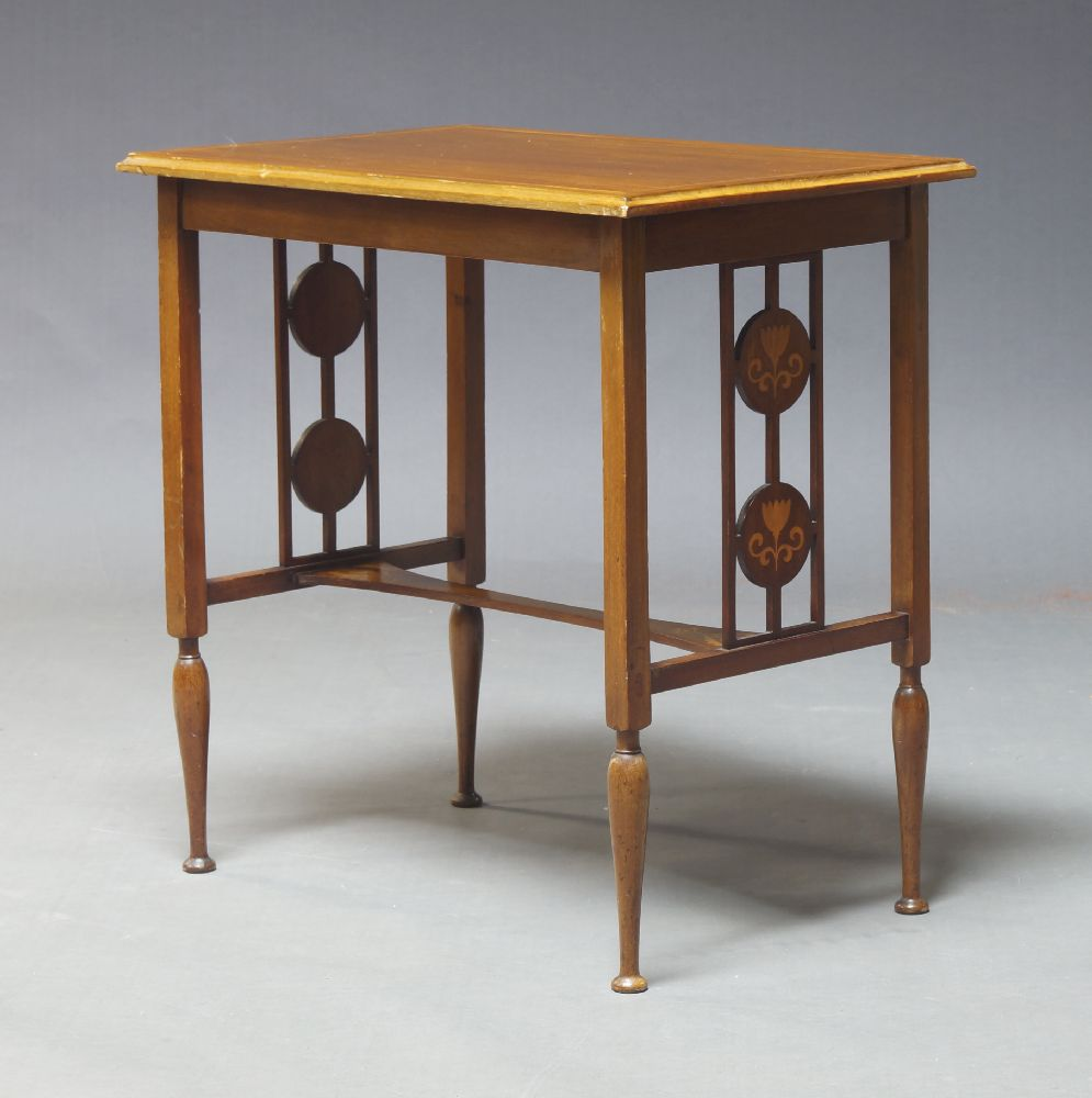 An Edwardian mahogany and inlaid side table, the rectangular top on square section supports, with