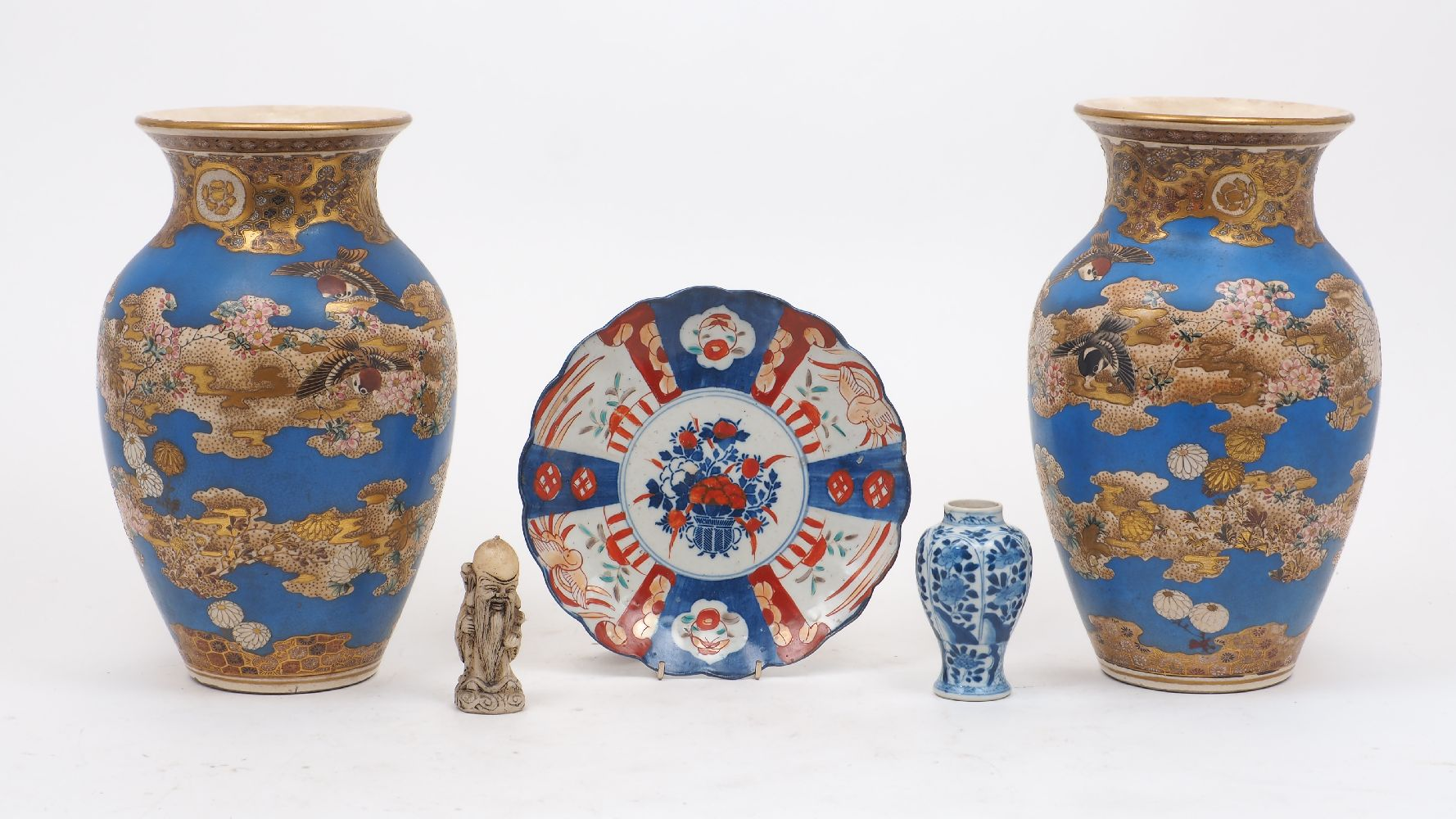 A pair of Japanese Satsuma baluster vases, early 20th century, painted with floral sprays to a