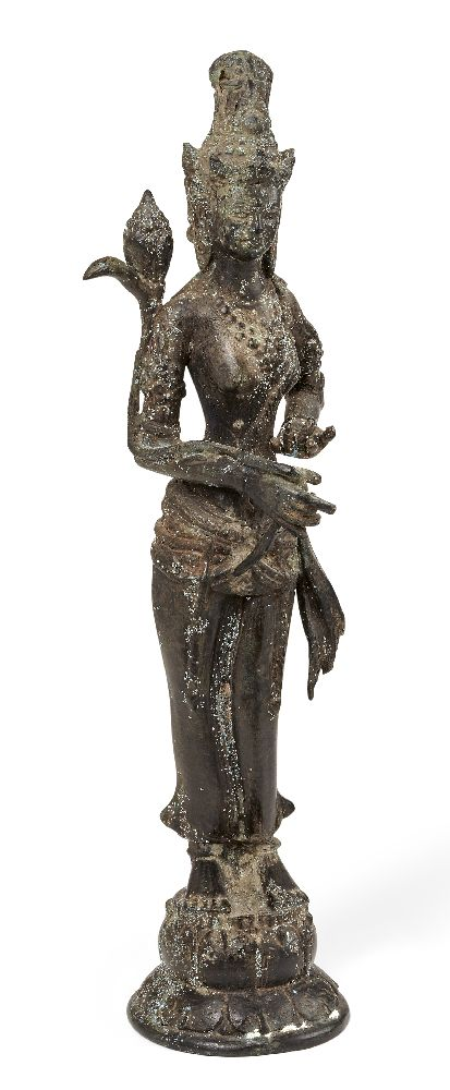 A Chinese bronze figure of Guanyin, 20th century, modelled standing on a lotus base holding a