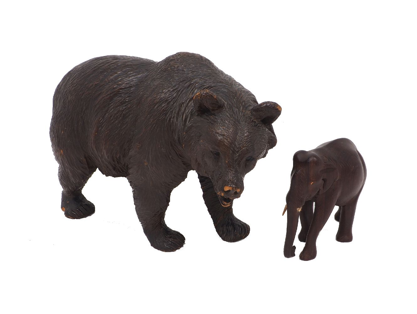 A carved Swiss 'Black Forest' bear, early 20th century, with inset bead eyes, 30cm long; together