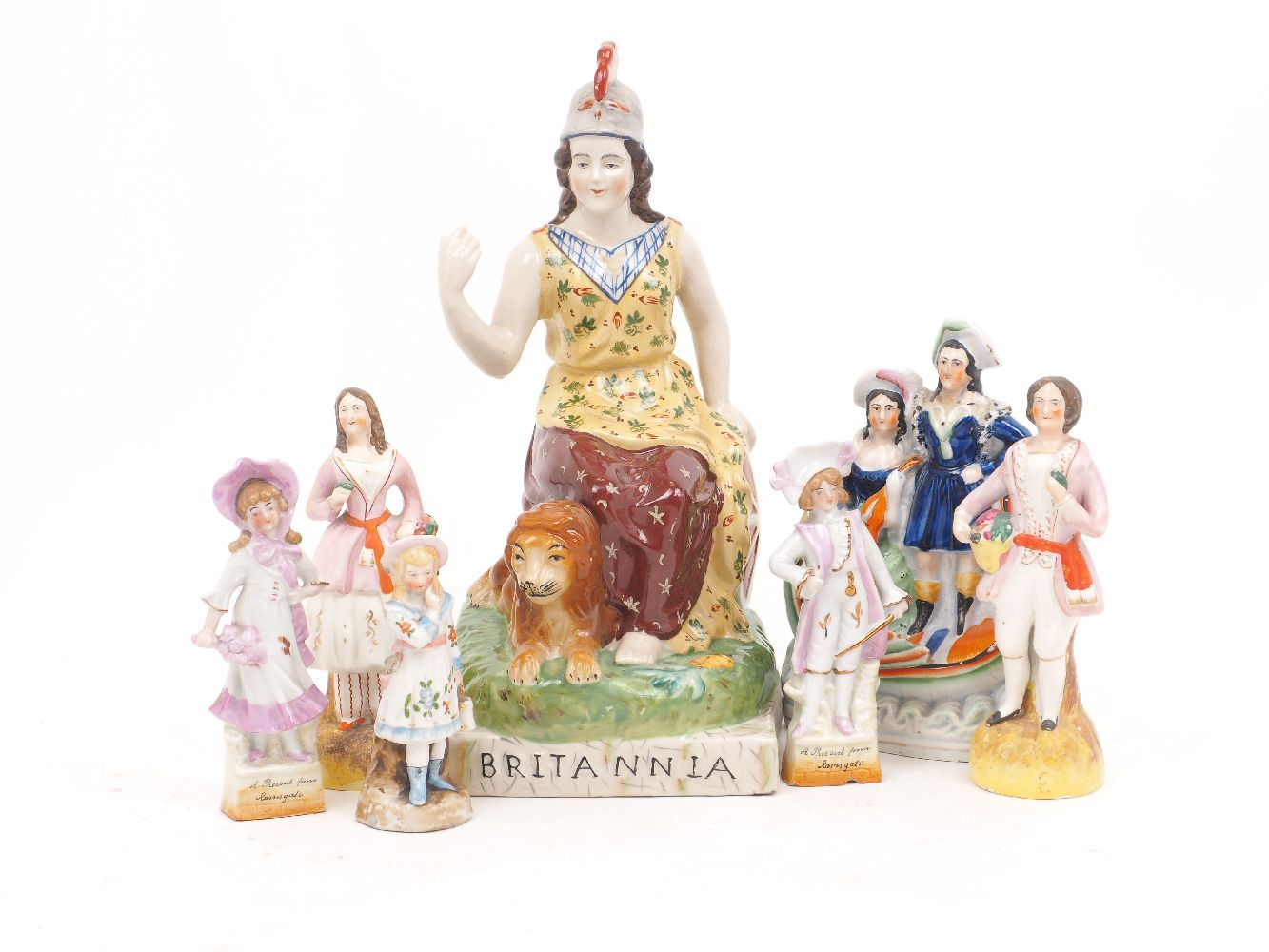 A large Staffordshire figure of Britannia, 19th century, seated, with a lion recumbent at her