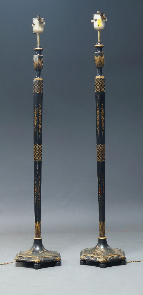 A pair of black painted and parcel gilt Chinoiserie floor lamps, early to mid 20th Century, with