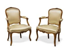 A pair of Louis XV beech fauteuils by Jean Boucault, mid 18th Century, one chair stamped 'Boucault',