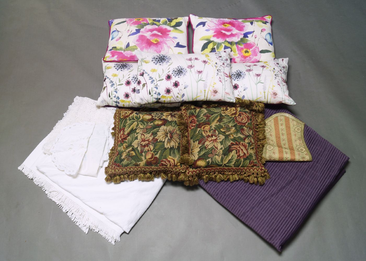A quantity of cushions, comprising seven pairs of tapestry style cushions and seven further