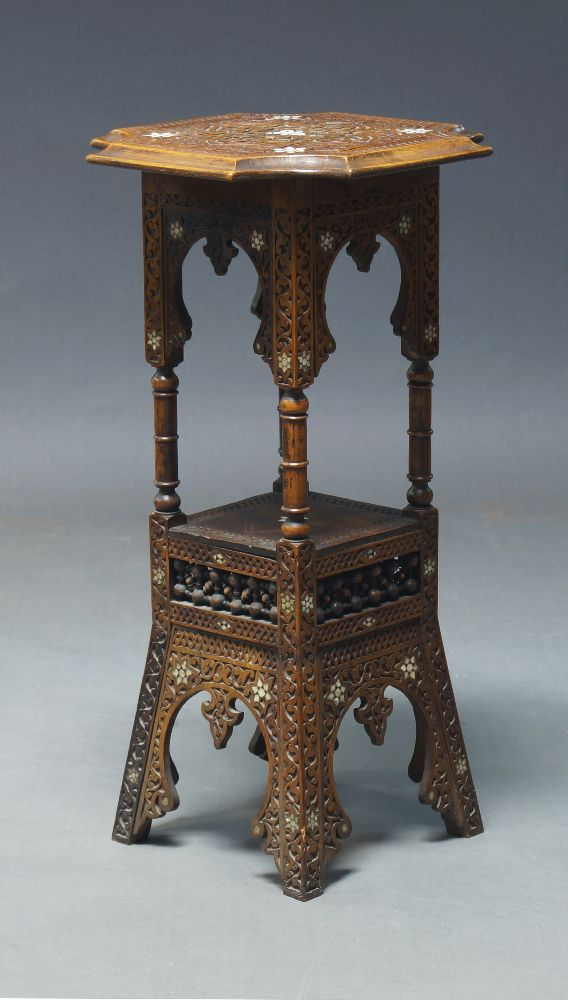 A Syrian mother of pearl inlaid two tier stand, early 20th Century, the shaped and carved top with