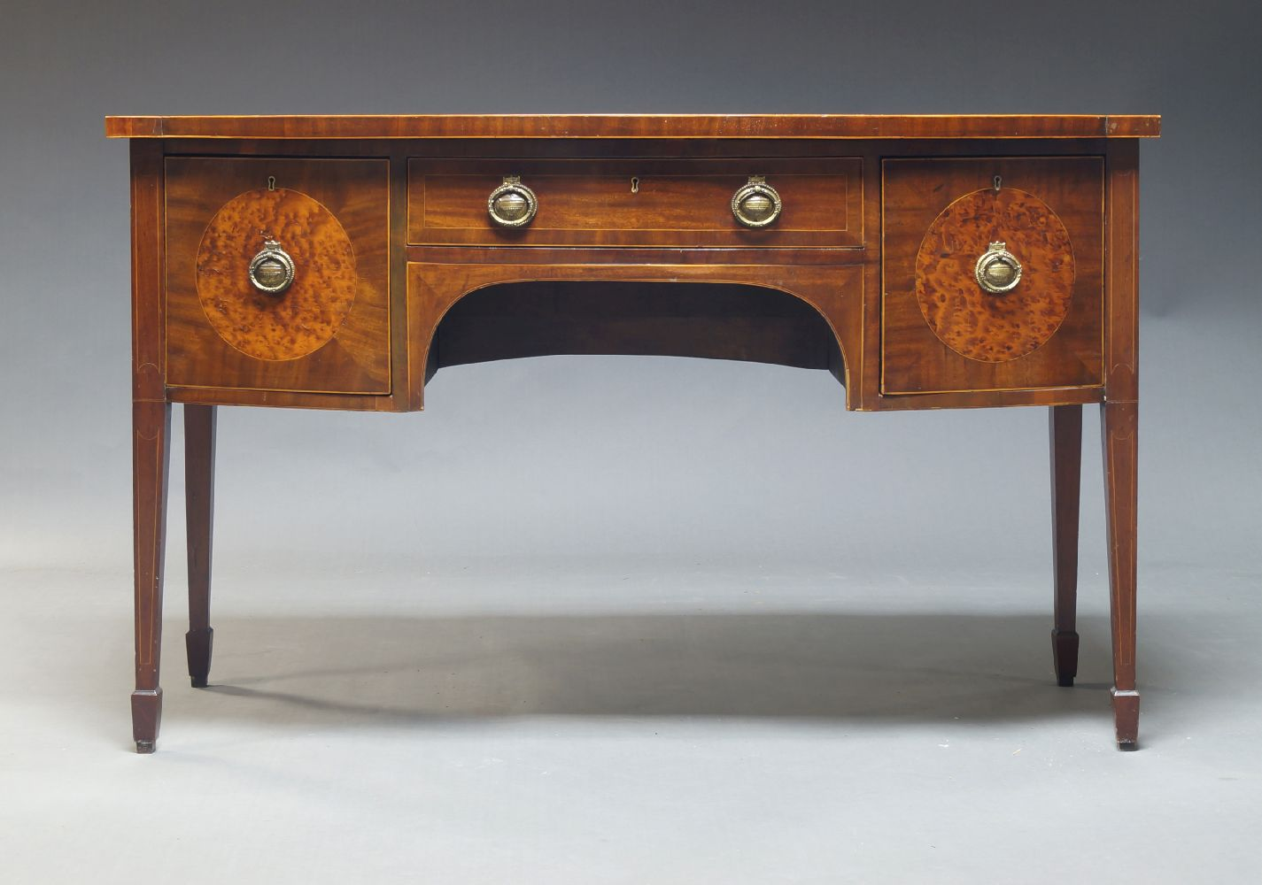 A Regency style mahogany and line strung sideboard, early 20th Century, with frieze drawer flanked