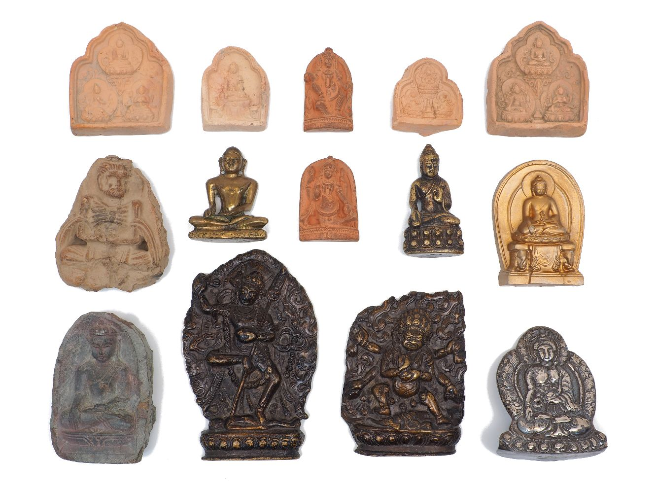 A group of miniature deities, 19th/20th Century, including a bronze plaque of Vajravarahi standing