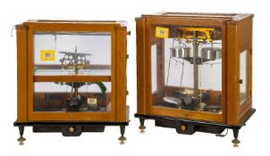 A cased set of weighing scales, early 19th century, the glazed panels and sliding front door opening