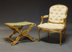 A Louis XV style gilt fauteuil, mid 20th Century, the cartouche shaped backrest with floral carved