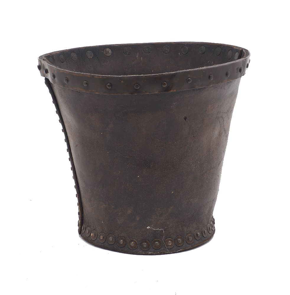 A leather fire bucket, 19th century, of studded panel construction, 26cm highPlease refer to