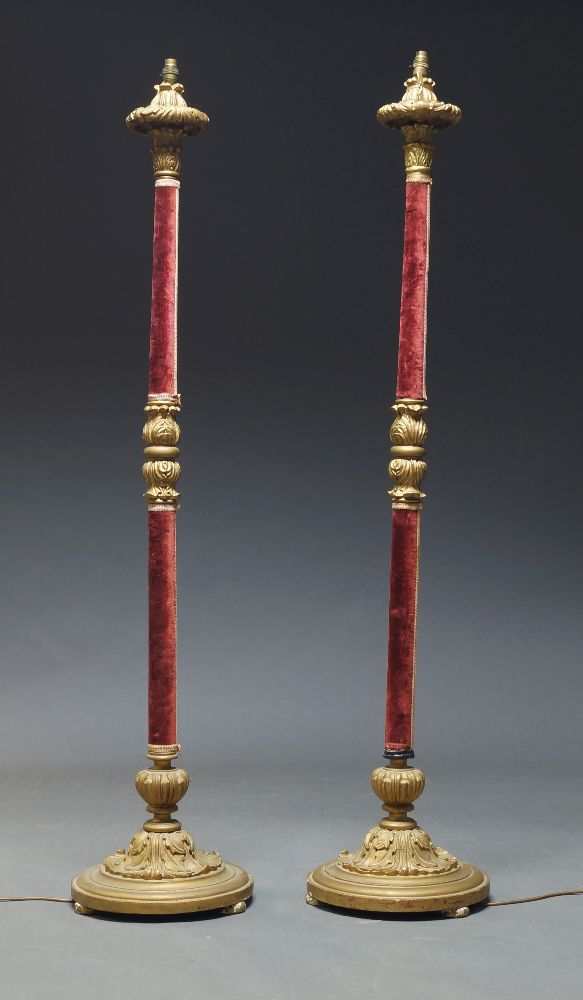 A pair of Victorian style giltwood and velvet standard lamps, mid 20th Century, with carved