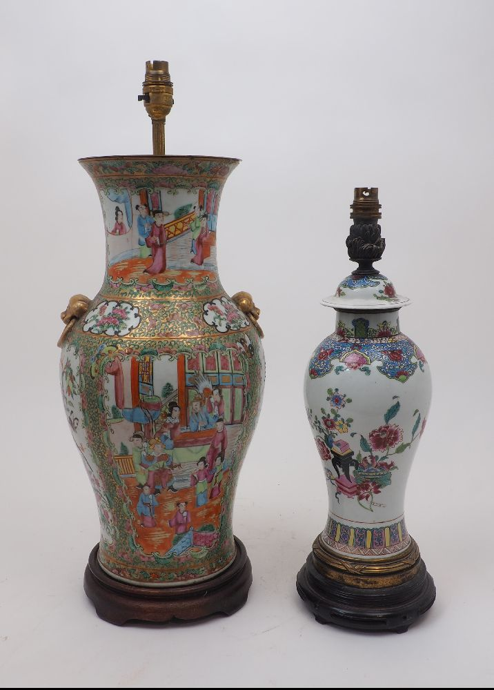Two Chinese porcelain vases, 19th century, with a Canton porcelain vase painted in famille rose