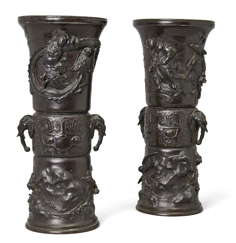 A pair of large Japanese bronze sleeve vases, Meiji period, each cast to the central section with