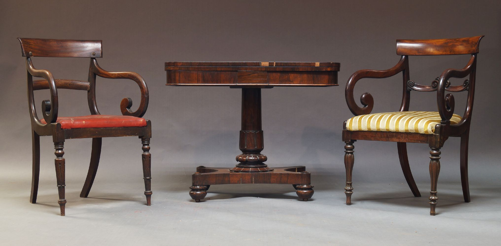 A Regency rosewood card table, the fold over top enclosing green baize lined playing surface, on