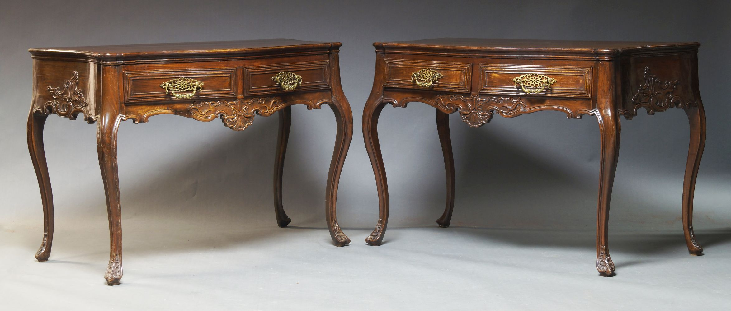 A pair of Louis XV style provincial side tables, 19th Century and later, with serpentine tops